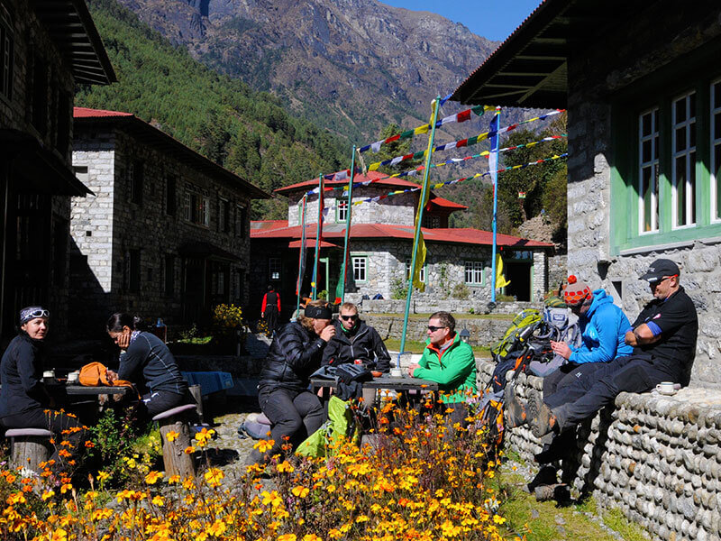 Tourists chilling in the sun before trekking